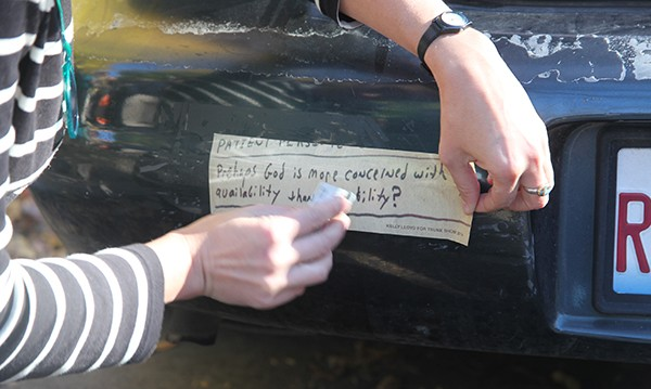 "For October's Trunk Show, artist Kelly Lloyd displayed her bumper sticker that featured a found quote: ""Prehaps God is more concerned with my availability than my ability?"""
