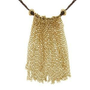 Fringe necklace of gold, gemstones, and Gore-Tex by Guy Lovin, $139, at Tula
