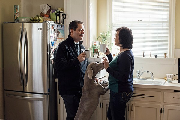 Garcia with his wife, Evelyn Chinea (and dog, Mia), in their Little Village home - JEFFREY MARINI