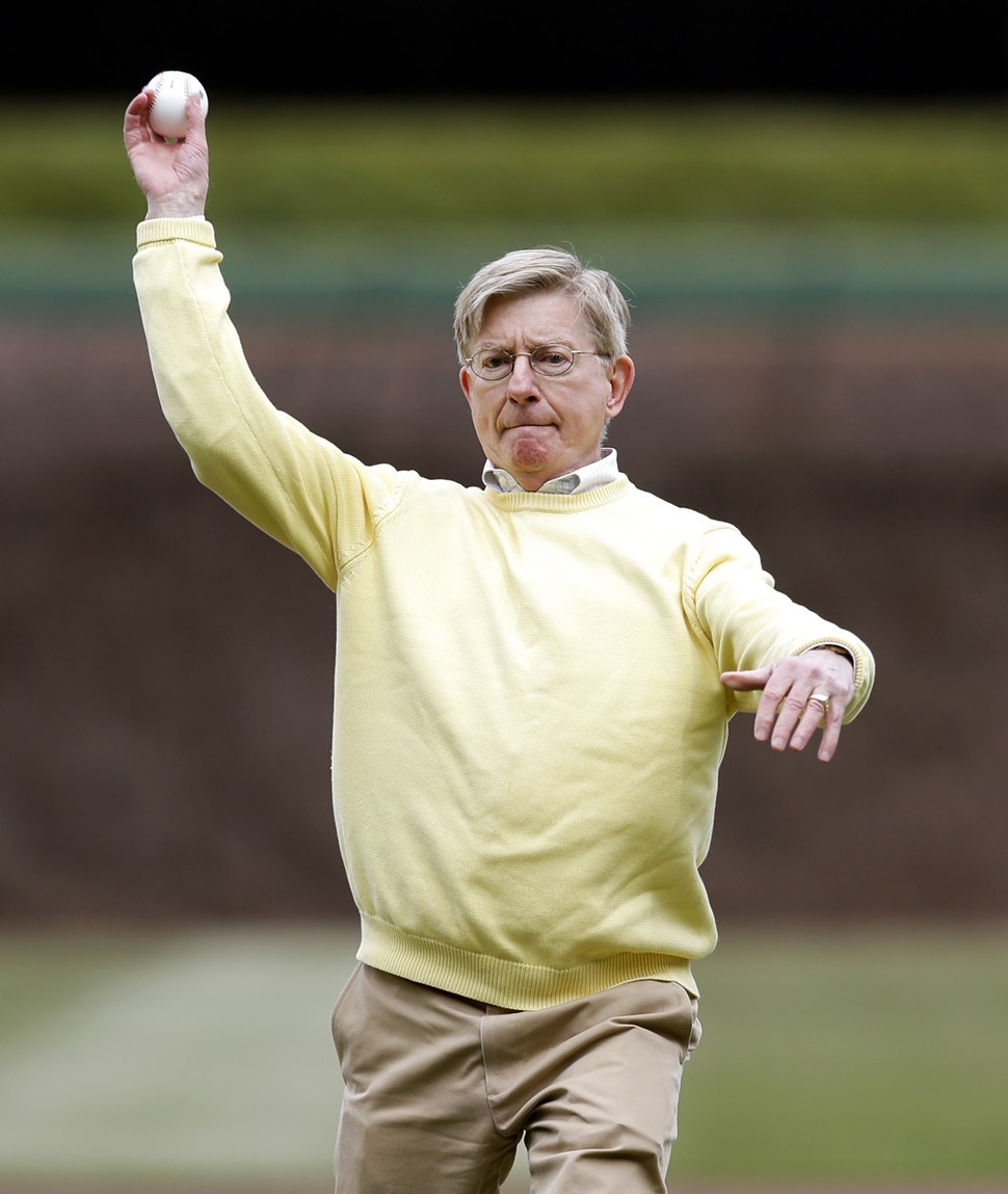 George Will throws the ceremonial first pitch before a Cubs game in April. He was later unceremoniously dumped by the St. Louis Post-Dispatch.