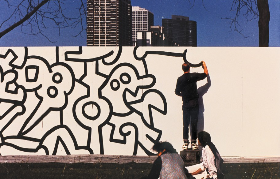 Haring began the Chicago mural project in May 1989 with an outline that would be filled in by Chicago Public Schools students. - MARCELINO Y. FAHD