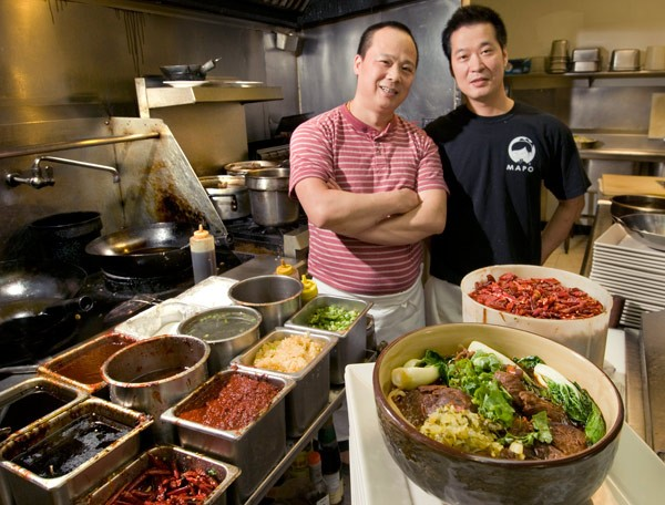 Head chef Jun Liu and owner Guang Chen with niu rou mian at Mapo Restaurant
