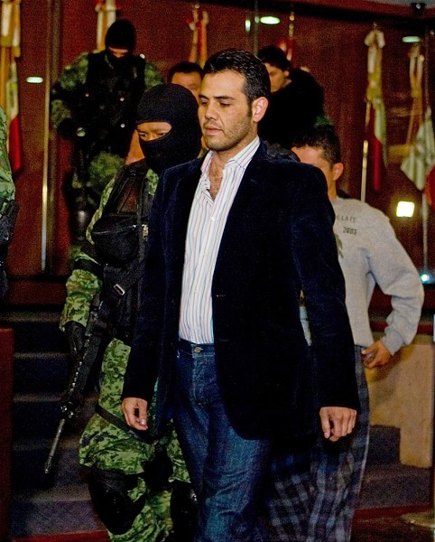 High-ranking Sinaloa cartel member Vicente Zambada is taken into custody to be presented to the press at the attorney general's office in Mexico City in March 2009. - LUIS ACOSTA/AFP/GETTY IMAGES