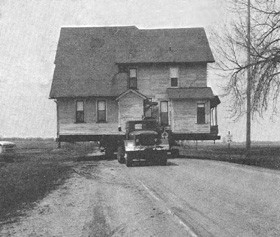 Houses that were once scattered across thousands of acres were hauled by truck to a centralized location, called Fermilab village, that now provides lodging for students and scientists. - FERMILAB