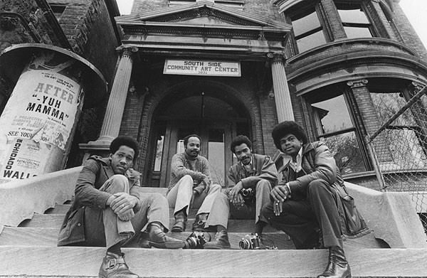 Howard Simmons, left, with fellow photographers Bob Black, John White, and Ovie Carter, photographed by Howard Simmons outside the South Side Community Art Center in 1973