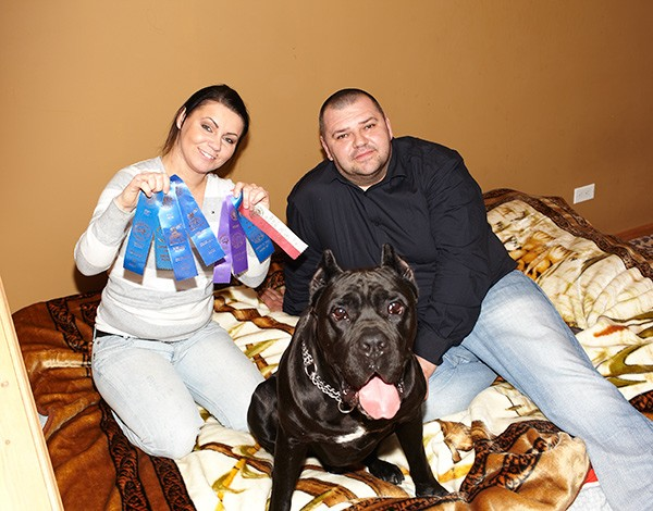 Ivo with his proud human parents, Agata Buczak and Marcin Proszek - COLLEEN DURKIN