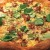 Jeff Mahin of Stella Barra Pizzeria tops a gumbo-inspired pizza with okra