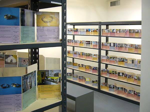 Jennifer Dalton, The Reappraisal, 2009, archival photographic prints in acrylic frames on wood and metal shelves - COURTESY ELMHURST ART MUSEUM