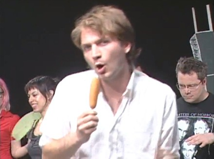 Jimmy Whispers corn-dog whispering on an episode of Chic-a-Go-Go