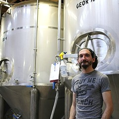 John Laffler with Off Color's tanks, which are named for dead pets.