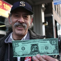 Jorge Mujica, 25th Ward aldermanic candidate, holds up a fake $15 bill with his image.