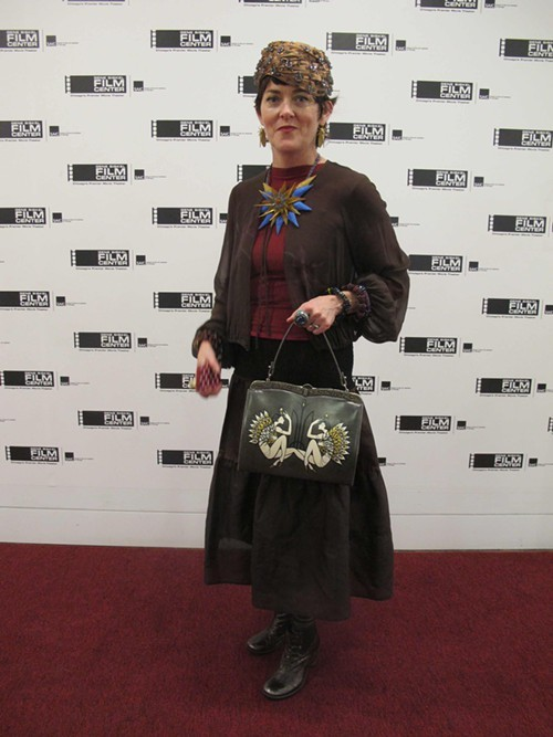 Jules Breen of The Antique and Resale Shoppe with a bag by Alicja Pulit...