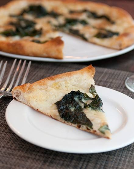 Kale and caramelized onion pizza has a satisfyingly chewy crust.