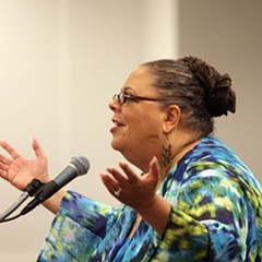Karen Lewis raises her hands at Mayor Rahm's gall.