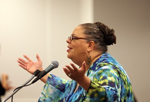 Karen Lewis raises her hands at Mayor Rahms gall.