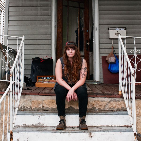 Kelly Nothing on the front porch of Animal Kingdom, the DIY venue she operated with her roommates. - ANDREA BAUER