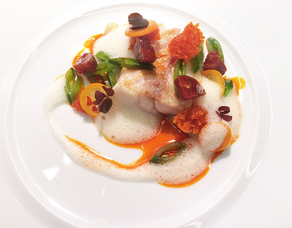 Kumquat coins lend an intense acidity to a meaty sturgeon fillet.