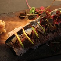 See what the sushi chefs are slicing up at Momotaro