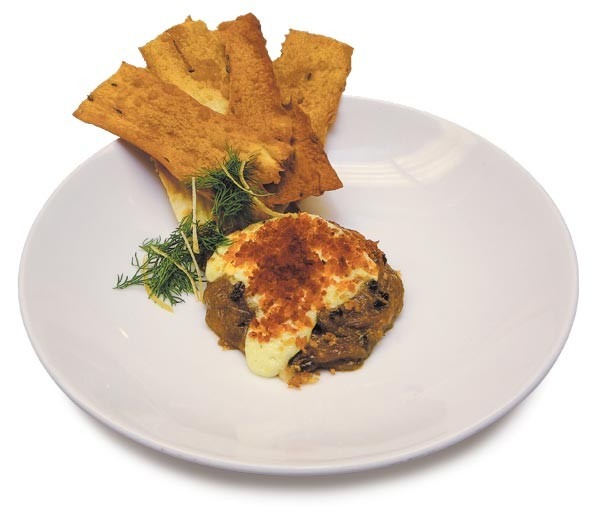 Leek, celery root, and gjetost gratin with aioli and caraway crackers