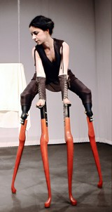 Oakland-based multimedia artist Lisa Bufano dances with stilts she made herself. - GERHARD ABA