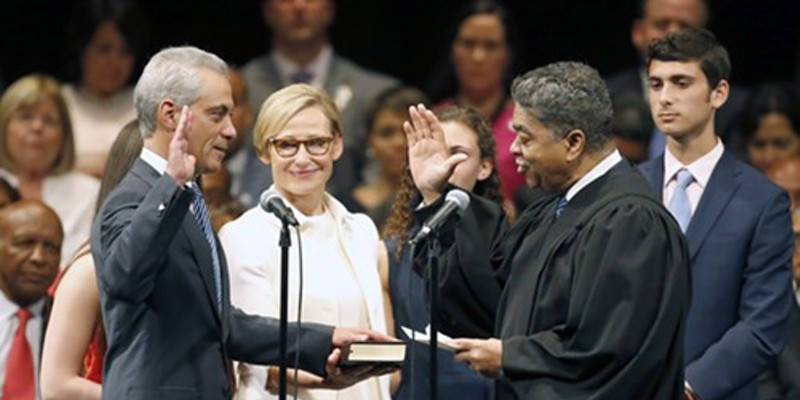 Mayor Rahm Emanuel is sworn in for his second term by Cook County chief judge Timothy Evans.