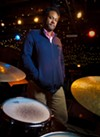"""<big>Mike Reed</big> is a jazz drummer and composer who books and produces the Pitchfork Music Festival, founded the Brilliant Corners of Popular Amusements Festival, and helps program the Chicago Jazz Festival and Umbrella Music Festival.  <a href=""""/chicago/people-issue-mike-reed-the-improviser/Content?oid=5215873"""">""""You find a bunch of people who aren't really 'fitting in' and they've got their own ideas.""""</a>"""