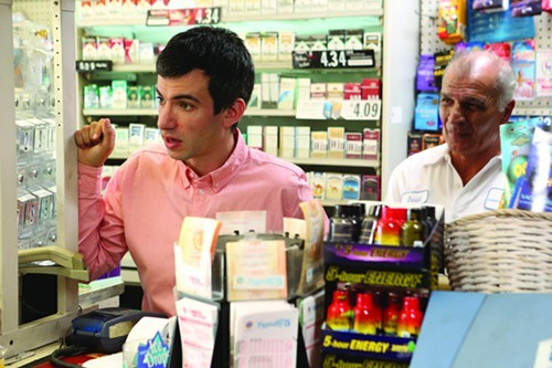 Nathan Fielder helps a gas station owner.