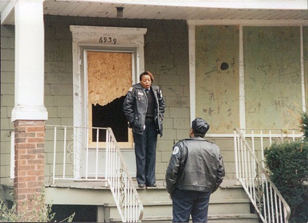 Officer Adams, standing on a porch in the early 2000s - COURTESY DONNA ADAMS