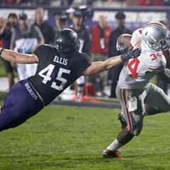 Ohio State running back Carlos Hyde (34) scores past the outstretched hand of Northwestern linebacker Collin Ellis (45) in Evanston on Saturday. And Mayor Rahm was here too!