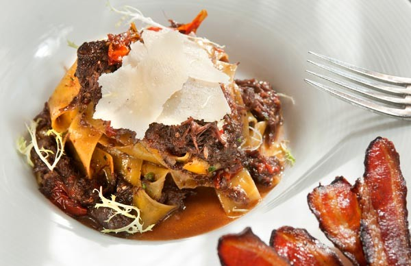 Pappardelle with veal cheek ragout, honey-peppered bacon