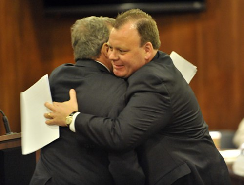 Patrick D. Thompson--the D is for Daley--embraces his uncle, county commissioner John Daley, after joining the water reclamation district board in 2012.