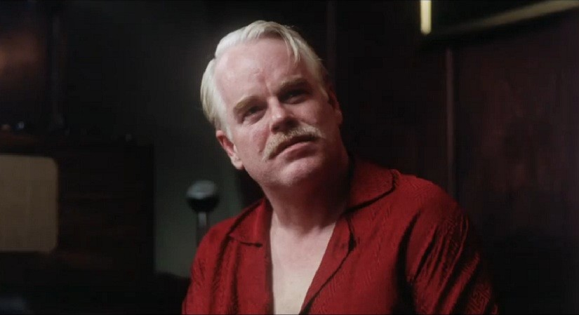 Philip Seymour Hoffman as charismatic leader Lancaster Dodd in The Master