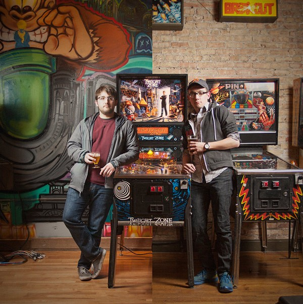 Philip Tibitoski (left, at Emporium) and Ben Perez (right, at Logan Arcade) give a lean to a Twilight Zone pinball machine. Pretty eerie, right?