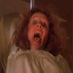 Piper Laurie, as the title character's wacky mom, in Carrie (1976)