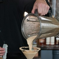 """Spiaggia's Brendan Smith whips up some """"dessert mustard"""" Pour into the prepared glass. Andrea Bauer"""