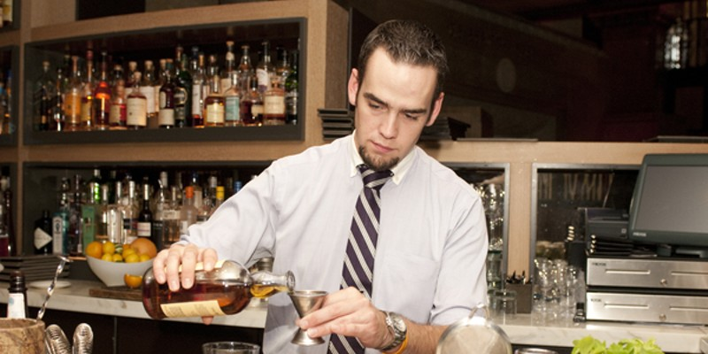 Patrick Henagahn makes the I Must Have Flown the Coop Pour two ounces of Balvenie 12-year-old single-malt scotch into a mixing glass. Andrea Bauer
