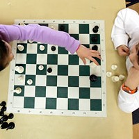 Rahm checkmates school chess teams