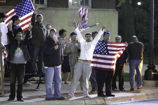 Residents of Dearborn, Mich., celebrate the news of Osama bin Laden's death. - AP