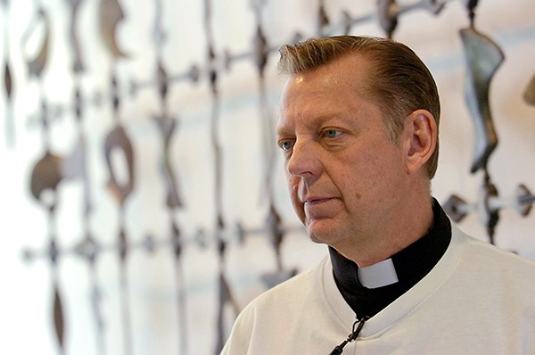 "Reverend Michael Pfleger insists that firearm activists push for easier access to guns with ""little concern for black and brown lives."" - STEPHANIE DOWELL/SUN-TIMES MEDIA"
