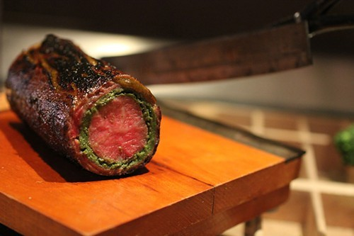 Ribeye roulade on a vintage paper cutter.