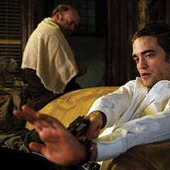Robert Pattinson in Cosmpolis, about to shoot himself in the hand