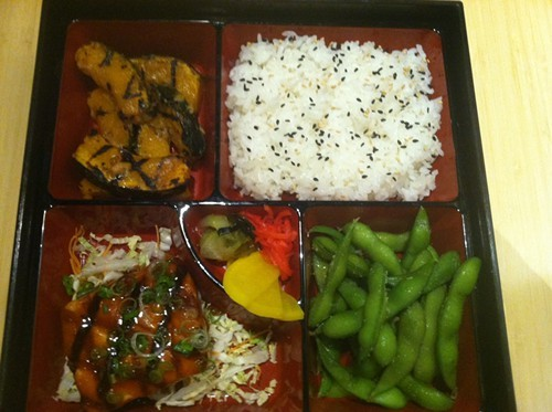 Salmon, kabocha squash, edamame, white rice with sesame seeds, and pickles