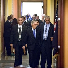 Senate Minority Leader Mitch McConnell heads to the floor after a closed-door meeting with Republican senators this morning.