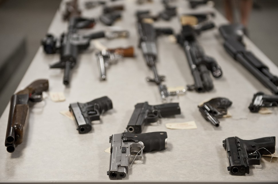 Some of the 7,444 illegal guns Chicago police say they recovered last year.