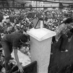 South Vietnamese civilians scale the 14-foot wall of the U.S. Embassy in Saigon, April 29, 1975