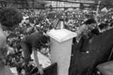 South Vietnamese civilians scale the 14-foot wall of the U.S. Embassy in Saigon, April 29, 1975 - AP PHOTO