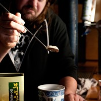 Step-by-step instructions for making Rodan co-owner Eric Chaleff's flu-fighting toddy Spoon three heaping bar spoons of Korean grain tea into a teacup.