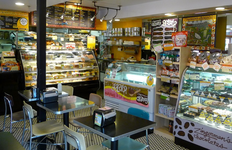 The section of the deli with baked goods, coffee, gelato, and chocolate