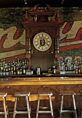 The bar, with one of the restaurant's three grandfather clocks - ANDREA BAUER