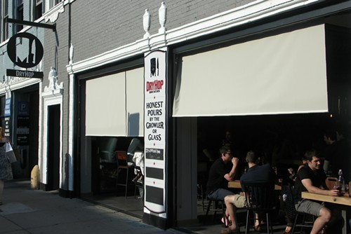 The facade of DryHop, open to the sidewalk to take advantage of a lovely afternoon